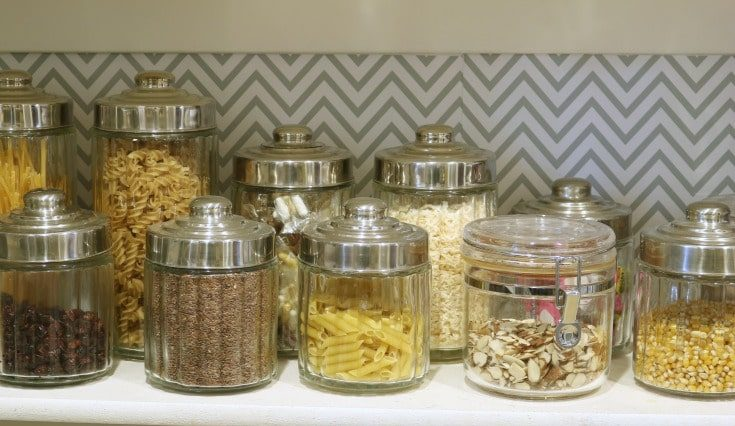 organized food containers sitting on shelf in pantry