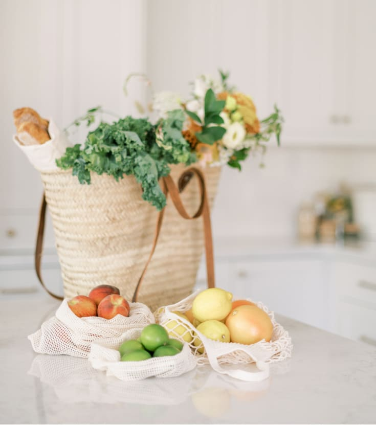 healthy natural bag full of groceries on a white kitchen counter