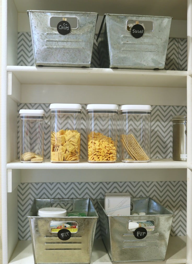 clear food containers with pasta in walk-in pantry