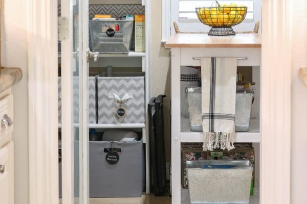open pantry door to organized pantry with small work space