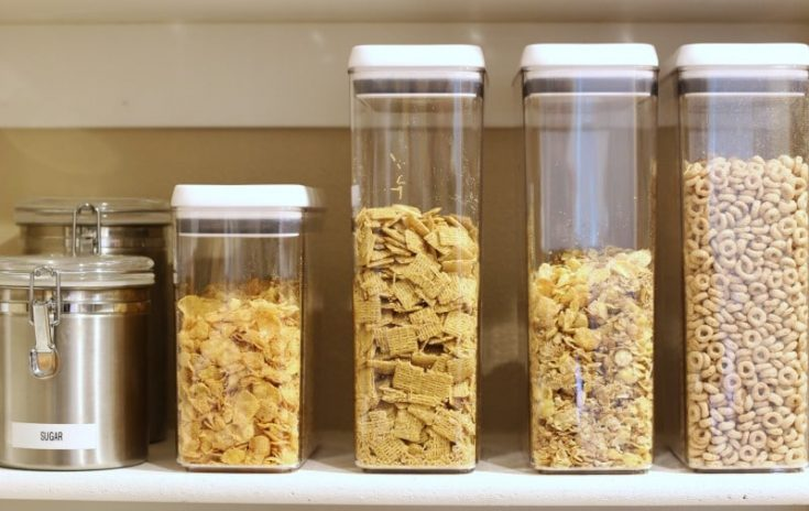 white cereal organizing containers in pantry