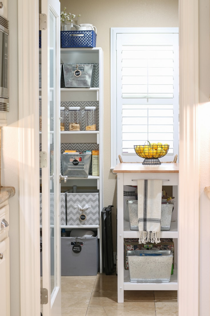 organized pantry with grey containers and organized shelves