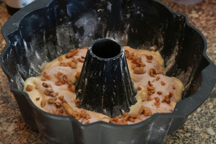 sour cream coffee cake in bundt pan ready to bake