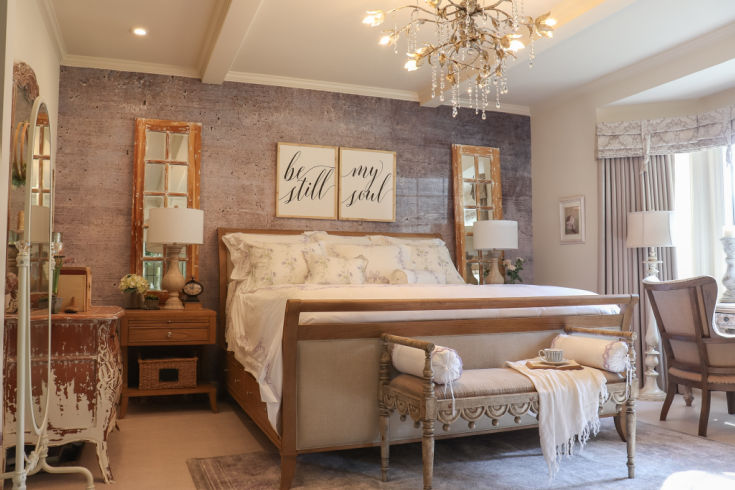 stunning sleigh bed in master bedroom with chandelier above