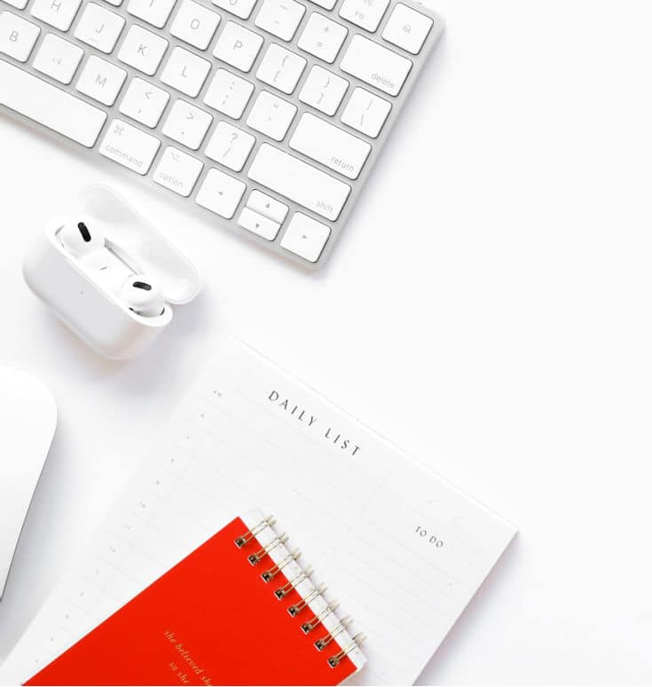 white desk with red notebook and keyboard to create viral Instagram reels