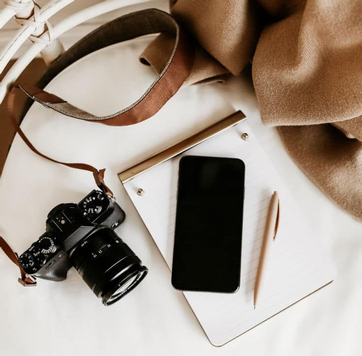 pen and paper with smart phone and camera to create viral Instagram reels