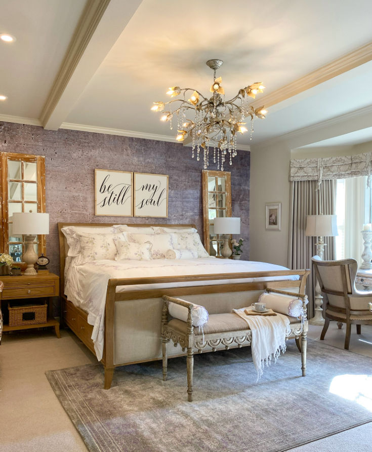 stunning sleigh bed with purple wallpaper accent behind