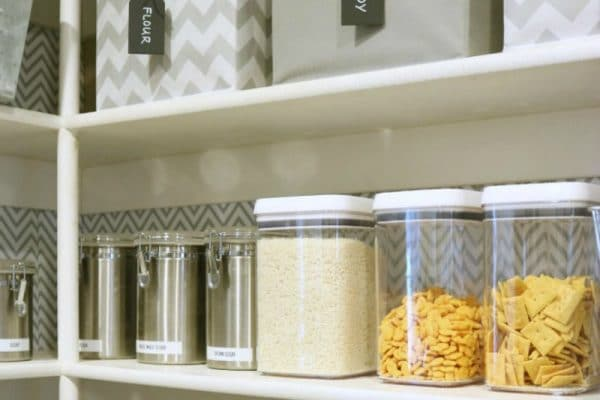 Labeled bins hide messy packages & clear containers reveal bulk foods