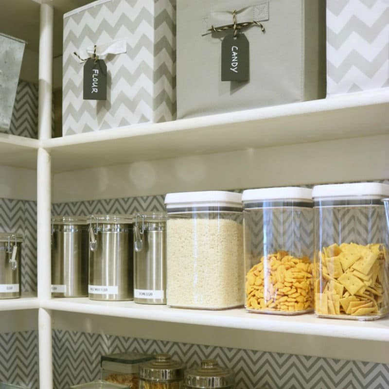 Labeled bins hide messy looking containers & clear bins reveal tidy foods.