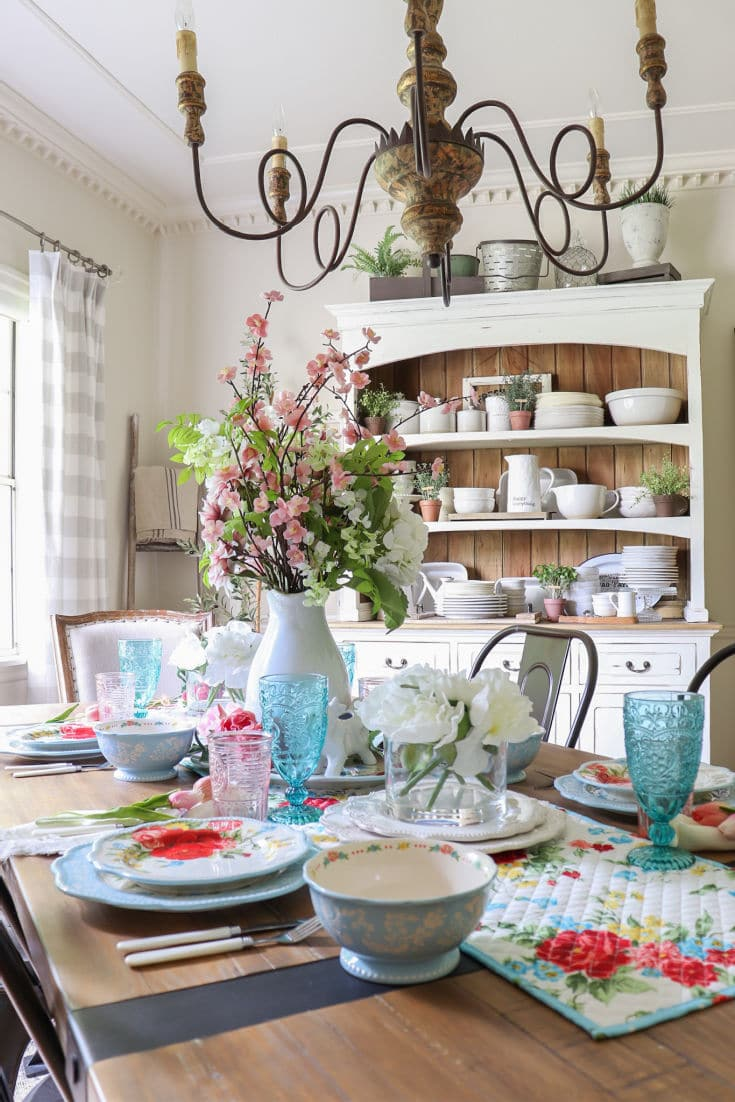 dining room table with pink and blue tableware