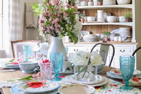 Colorful Summer Budget Tablescape with pretty floral plates and glassware