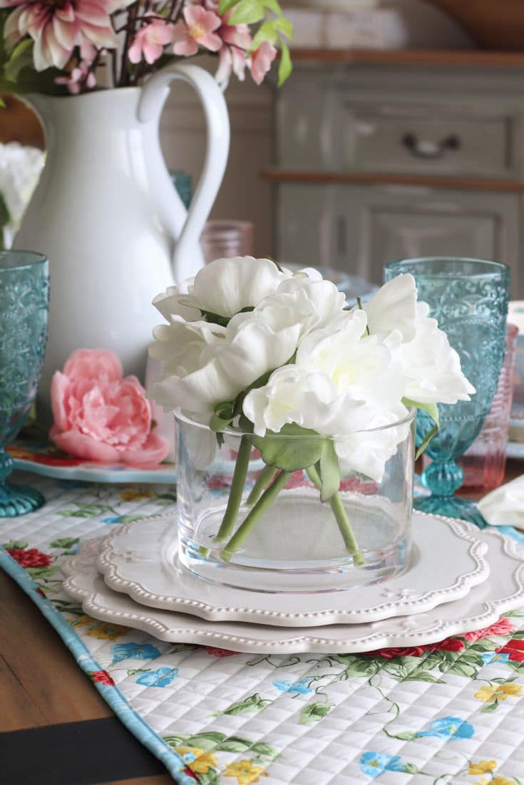 close up of white flowers in vase on dining table