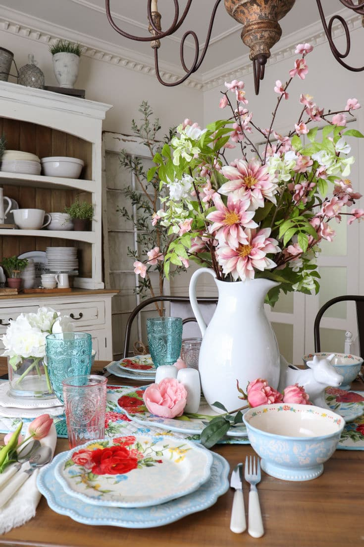 fresh florals with pink and blue accents on budget designer tablescape