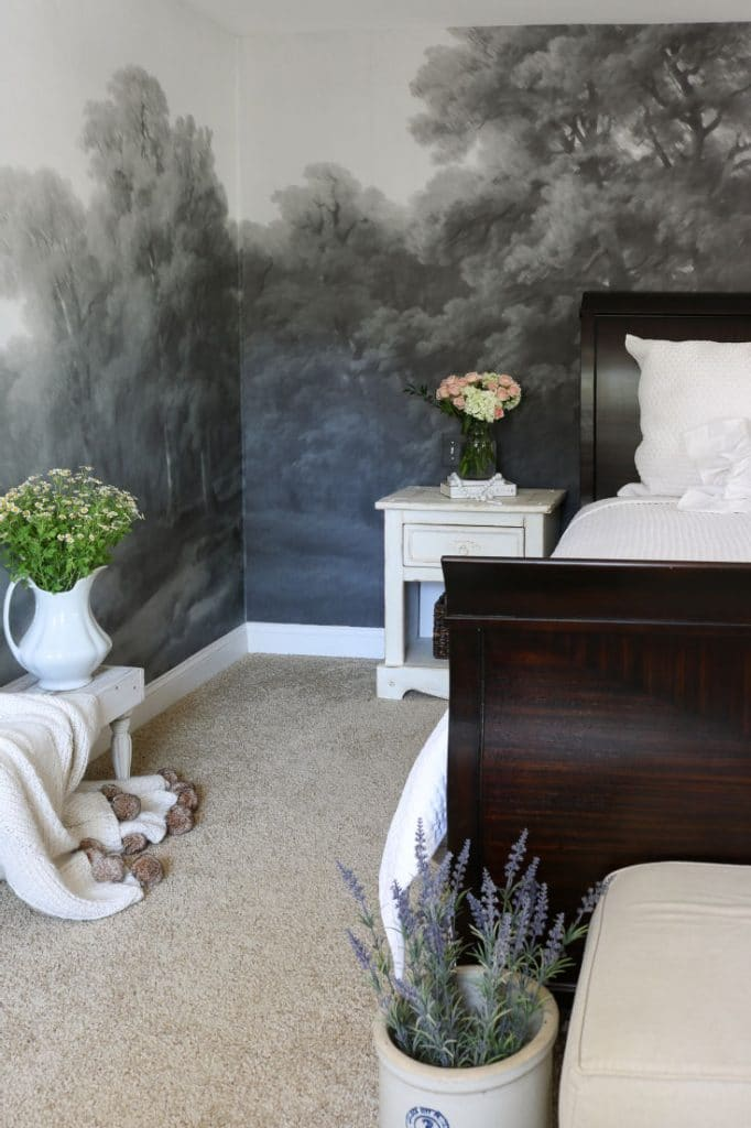 white bed with dark grey wall mural