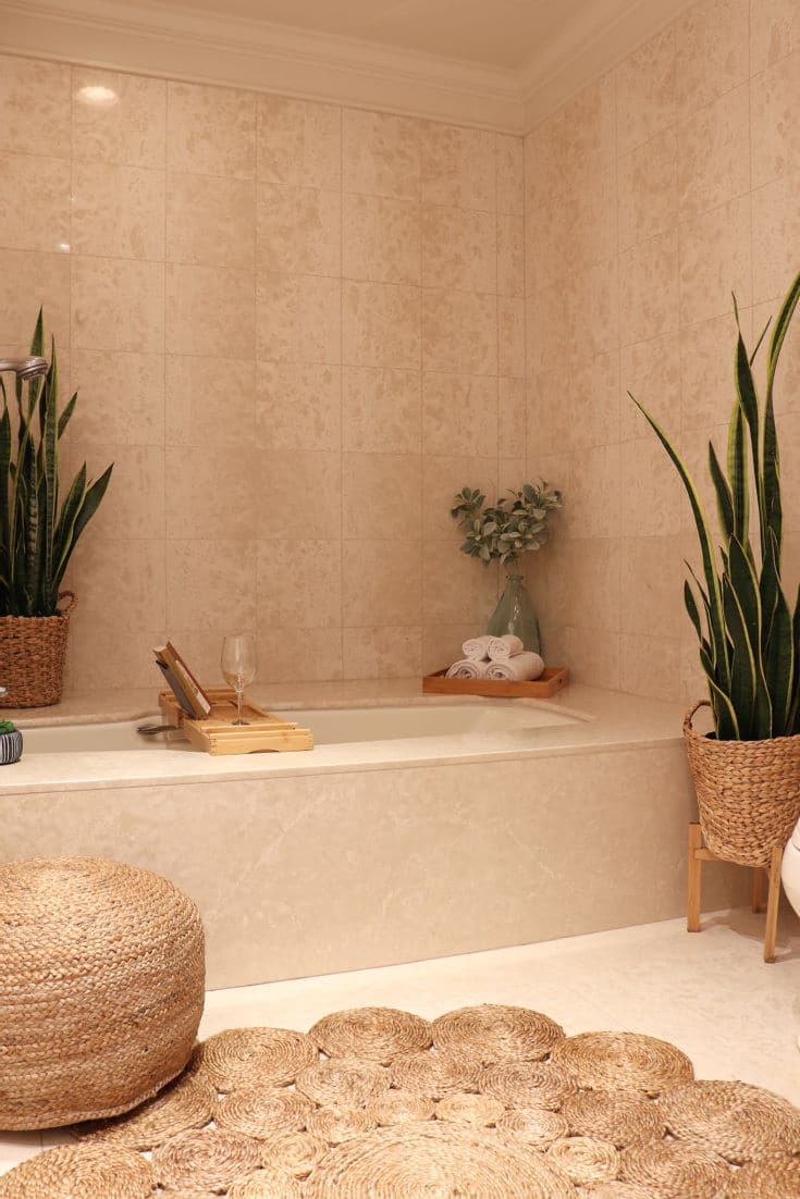 Boho bathroom decor with neutral natural textures, plants and woven pieces