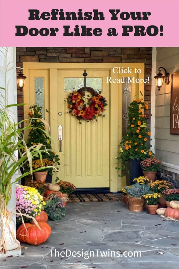 Beautiful gold painted front door decorated for fall with mums and pumpkins