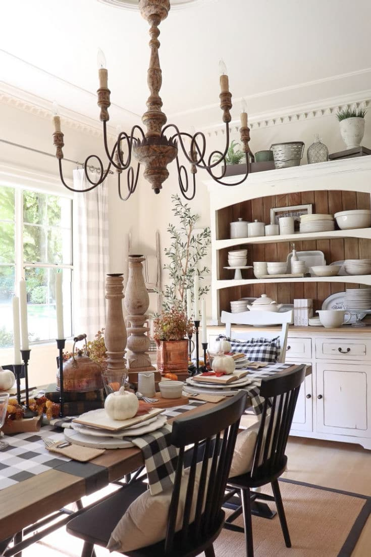 Fall dining room decor with buffalo plaid theme and pops of warm fall colors