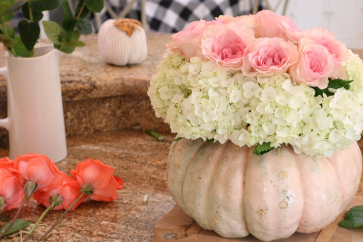 Step by step creating the pumpkin floral arrangement with roses