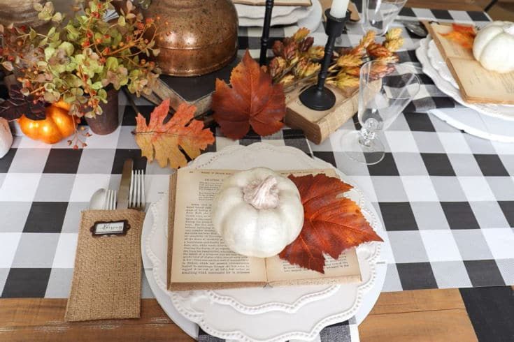 black and white buffalo plaid table runner with fall botanicals create festive tablescape