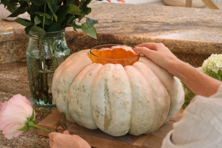 place a vase inside the pumpkin to use as floral vase