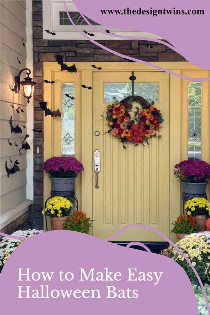 Front door and front porch decorated for fall with pumpkins mums and bats for Halloween