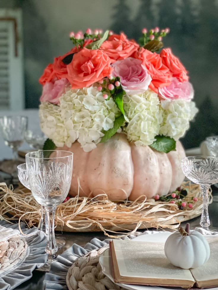 seasonal centerpiece with pumpkin vase and roses